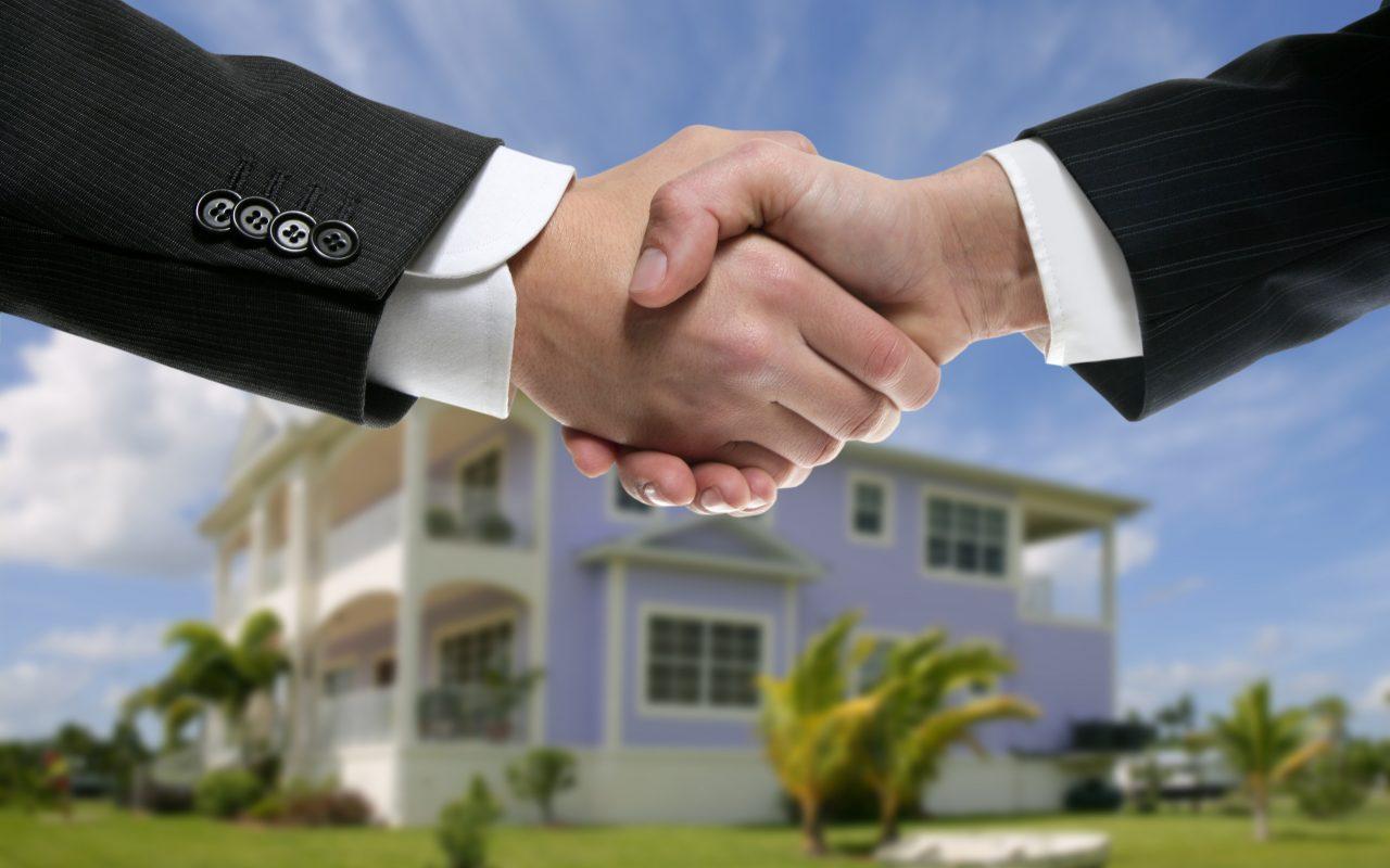 Businessman teamwork real state house partners shaking hands handshake